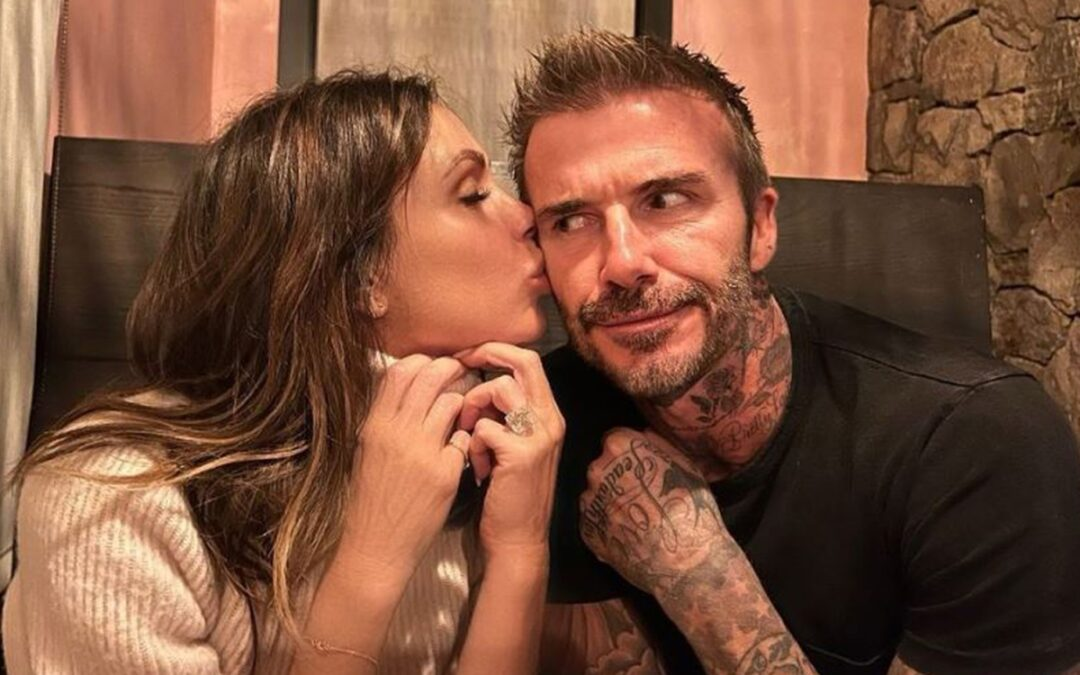 Victoria Beckham 'embarrasses' her young children as she kisses David on evening out